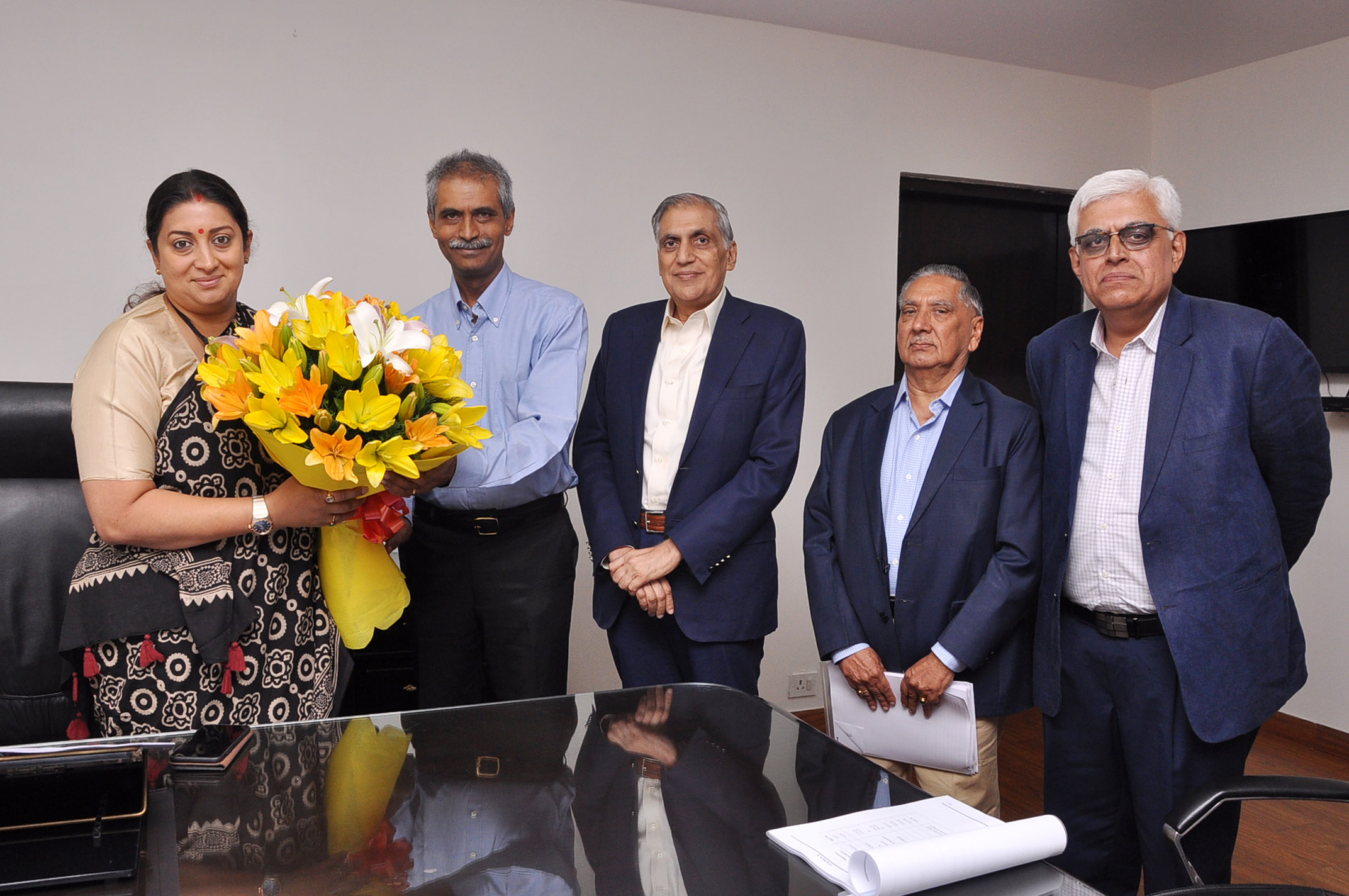 Hon'ble Minister of Textiles, Smt.  Smriti Zubin  Irani  being  greeted  by Dr. K V Srinivasan, Chairman, TEXPROCIL at her office in New Delhi on June 7, 2019.
