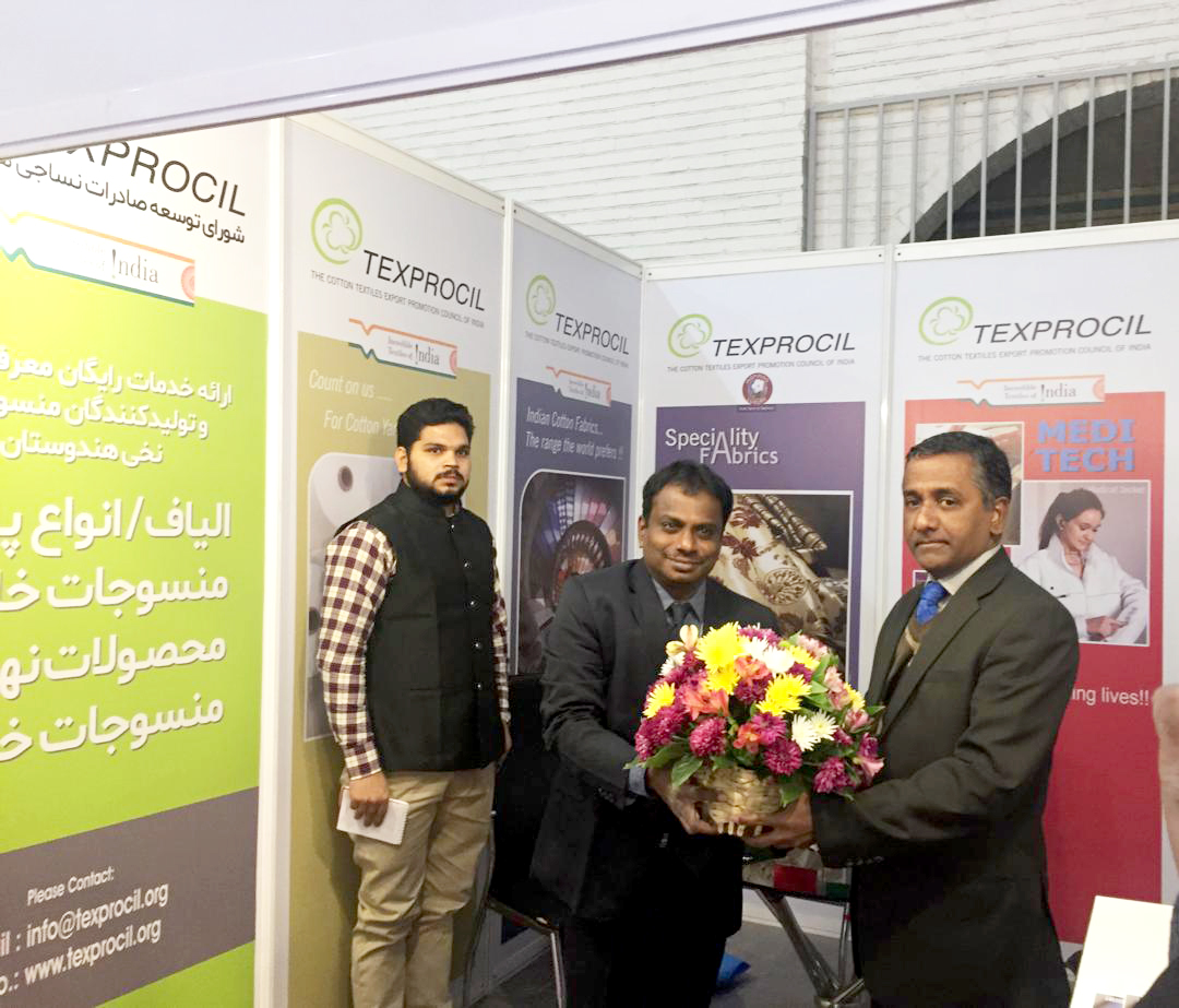 Shri Vinay Kumar and other officials from the Indian Embassy being welcomed at the Council's booth at IRANTEX 2019 by Shri A Ravikumar, Joint Director, TEXPROCIL